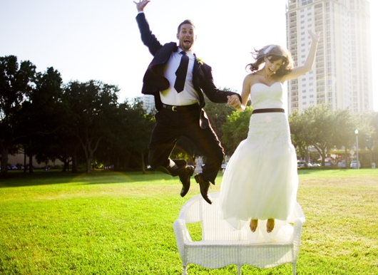 stylish bride and groom jumping