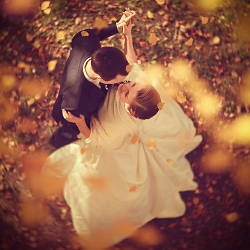 romantic fall wedding, couple dancing in the fallen leaves