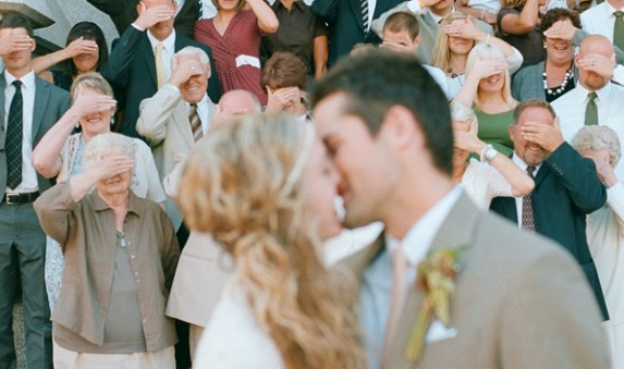 cute cover eyes wedding kiss photo