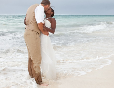destination wedding, bride and groom kissing in the sea