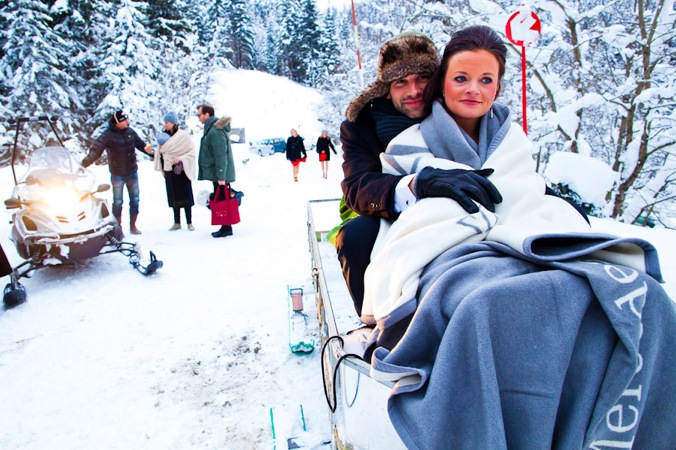 bride and groom on skidoo - winter wedding Austria