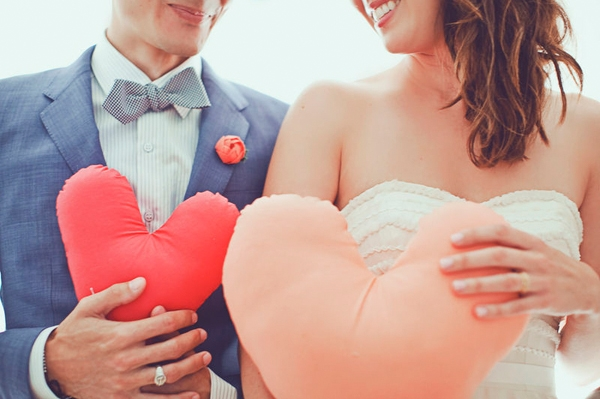 giant fabric hearts at wedding | heart themed wedding