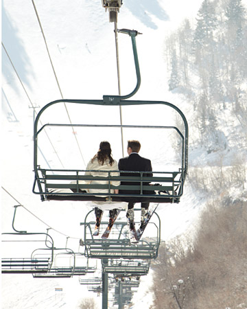 bride and groom on ski lift winter wedding