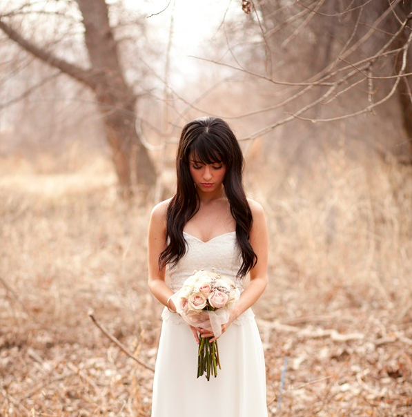 bride with bouquet in the woods