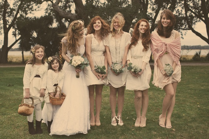 bride, bridesmaids and flower girls all in white