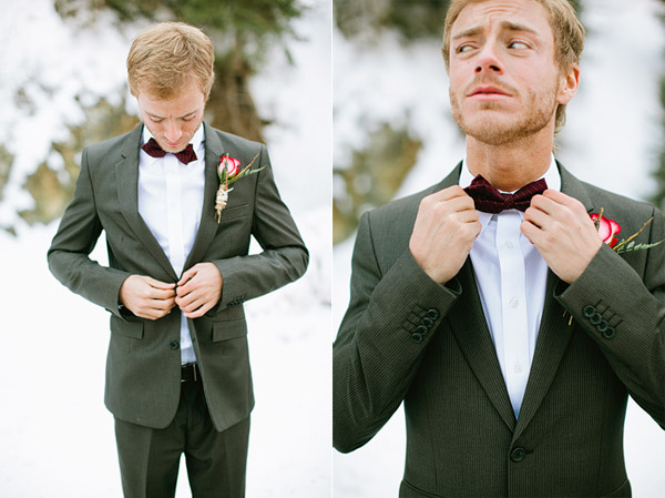 groom in a bow tie and grey suit in the snow