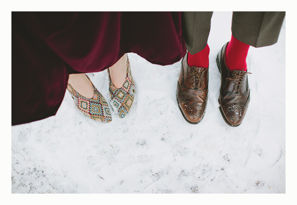 bride and groom shoes in the snow
