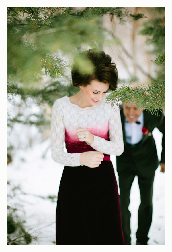 bride in the snow in red velvet wedding dress