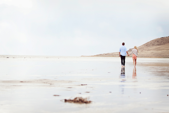 peach and blue beach engagement shoot