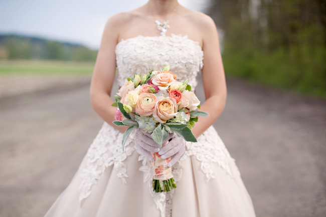 justin alexander wedding dress, peach bouquet and gloves