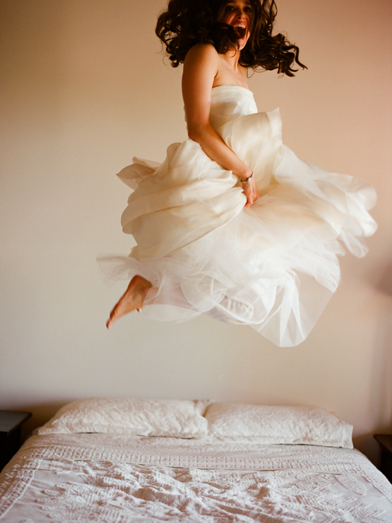 Elizabeth Messina bride jumping on bed