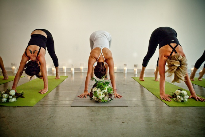bride and bridesmaids doing yoga | Andrea Lee Photography