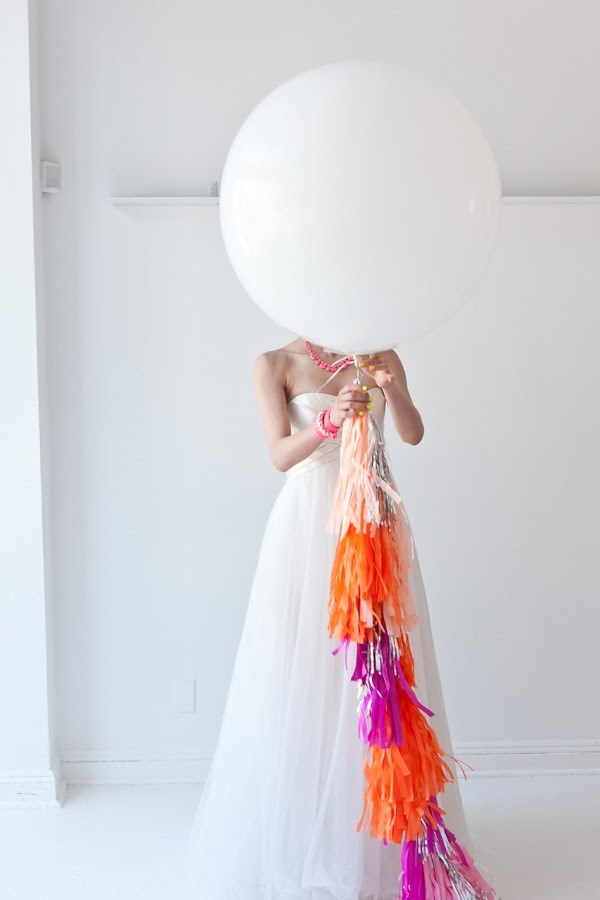 bride with geronimo balloon neon tassels