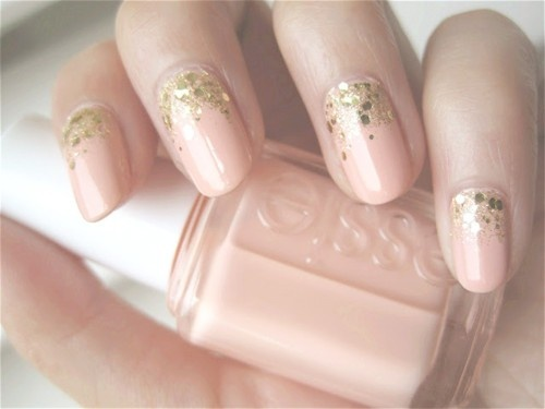 gold glitter and nude nail art