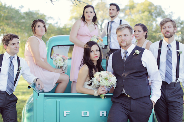 bridal party in truck at a wedding