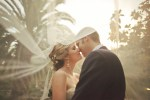bride and groom kissing under veil | Orange Turtle Photography (8)