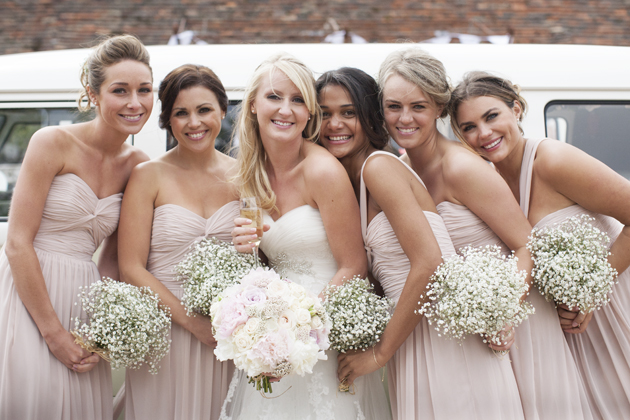 bride and bridesmaids with baby's breath bouquets