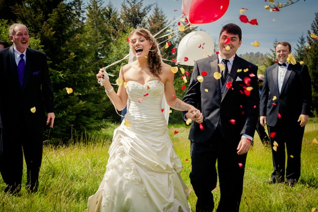 bride carrying balloons