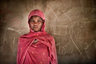 Protection - Child marriages -Mbera refugee camp:  A fifteen years old Afaid Maiga is a Malian refugee living in M'Bera refugee camp in Mauritania. Afaid never attended school, two years ago her and her family fled the violence in Northern Mali and sought refuge in M'Bera refugee camp in Mauritania.  At the age fourteen, her father forced her to marry a men much older than her. Afaid's mother opposed the marriage and filed her case with the M'bera refugee leader who referred her to UNICEF's partner InterSOS. Child protection network and InterSOS intervened and managed to convince the father and Afaid's new husband to break the marriage.  Now almost a year since Afaid's marriage has been nulled, she continues to live with her parents in M'bera refugee camp. Occasionally she visits a youth club but she doesn't want to undertake informal education programme saying that she wants to help her mother with house choirs.   Bassikonou, Hodh Ech Chargui, Mauritania.